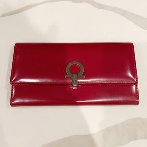 Salvatore Ferragamo red leather wallet.